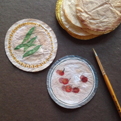 Tea bags art, craft idea, two round teabags painted like a plate with fruits and vegetables